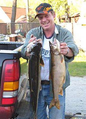 Gary Colman with his two lake trout cought on Green Lake.
